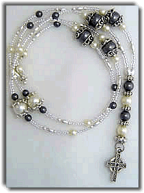 Gray and White Beaded Necklace with Cross